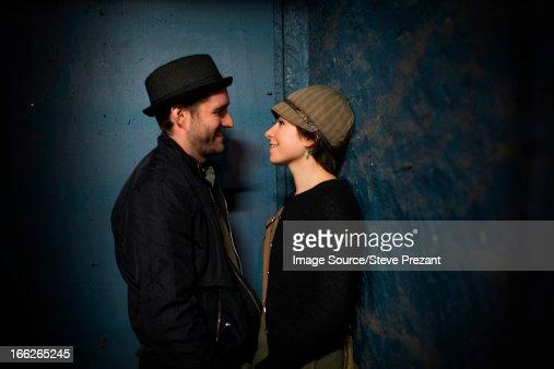 Couple talking in alleyway