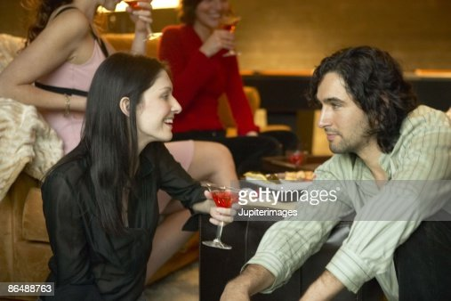 Couple talking in bar : Stock Photo