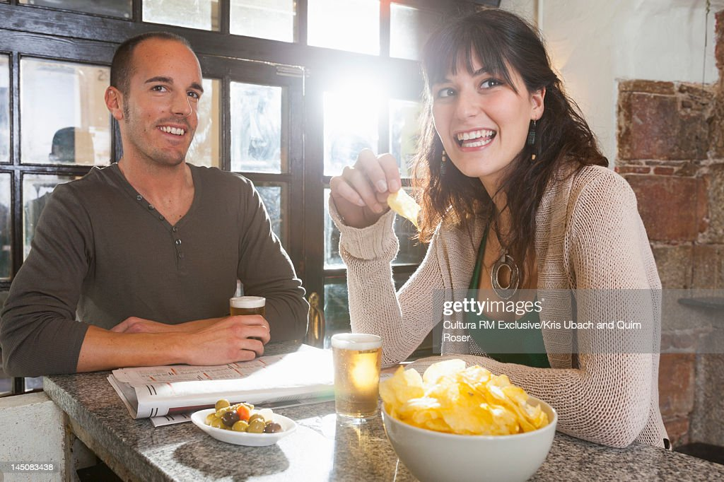 Couple talking in tapas bar