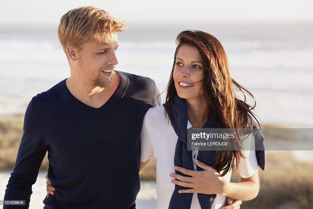 Couple talking on beach : Stock Photo