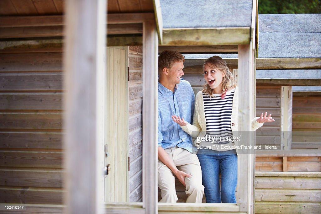 Couple talking on cabin balcony : Stock Photo