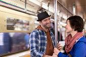 Couple talking on urban subway