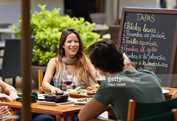 Couple talking over the table at restaurant