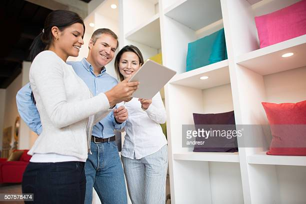 Couple talking to a saleswoman at a furniture store