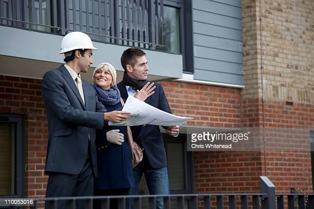 Couple talking to architect