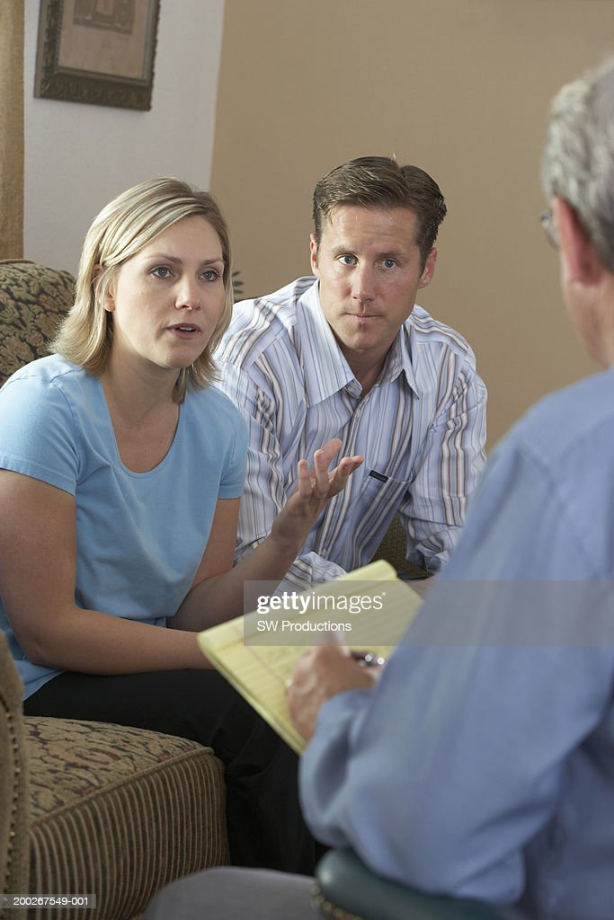 Couple talking to counselor at home : Stock Photo