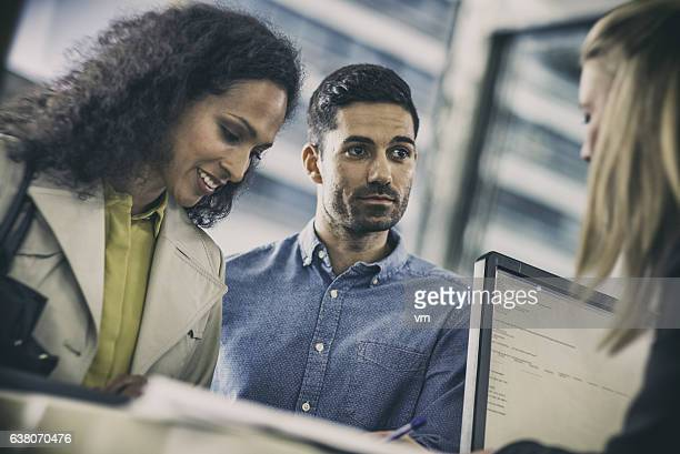 Couple talking to insurance agent at the counter