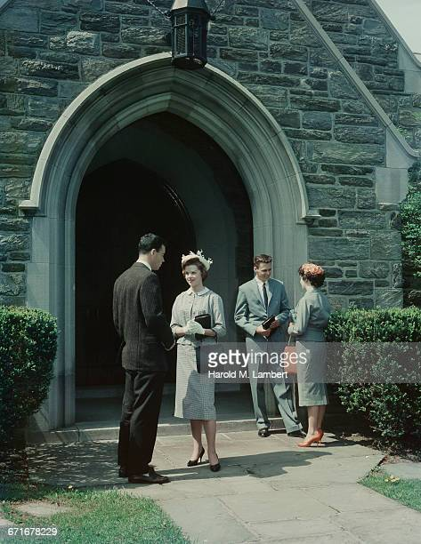 Couple Talking With Each Other While Standing Near Church Entrance