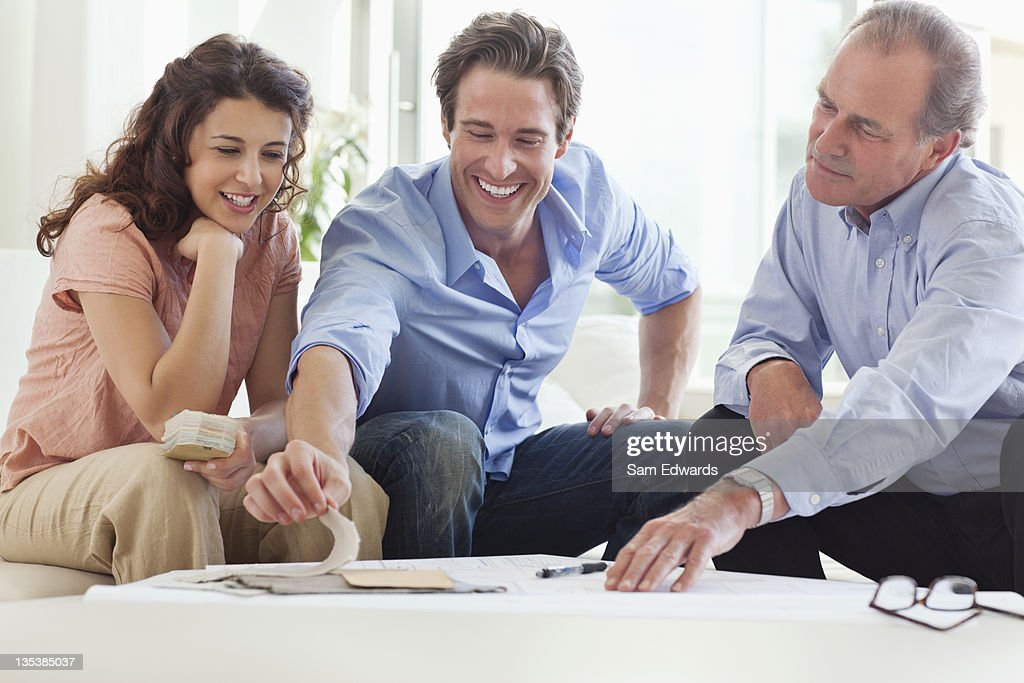 Couple talking with their financial advisor