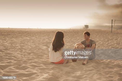 Couple talks on beach : Stock Photo