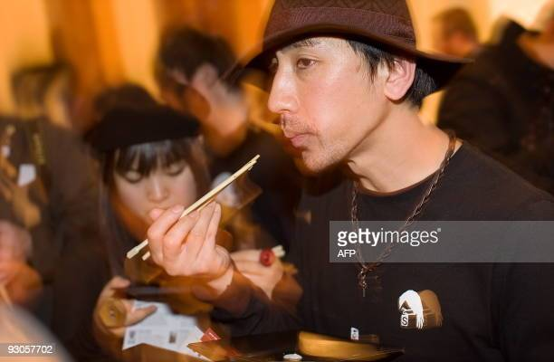 A couple test an entrant's sushi at the 'Seven Sushi Samurai' Sushi of the Year awards 2009 at the Olympia exhibition centre in west London on...