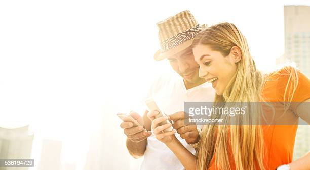 couple text messaging on the phone