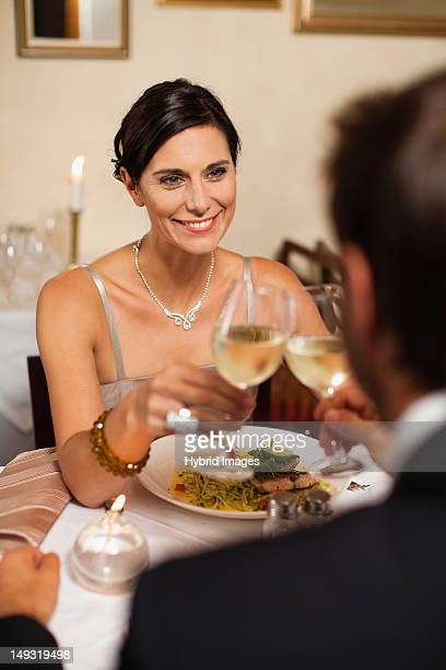 Couple toasting each other in restaurant