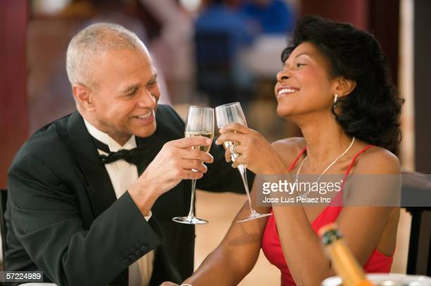 Couple toasting each other over champagne