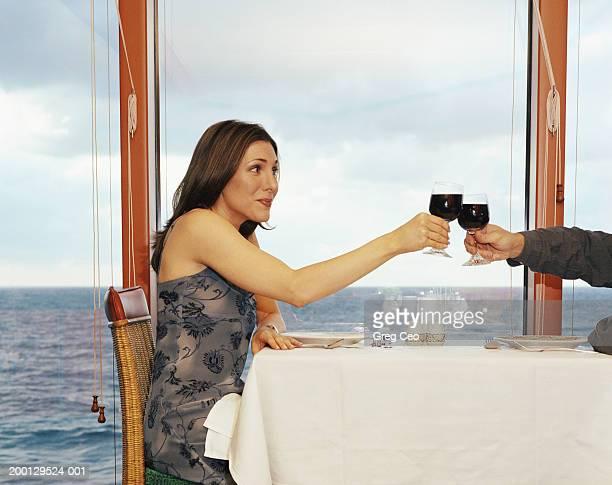Couple toasting glasses of wine on cruise ship