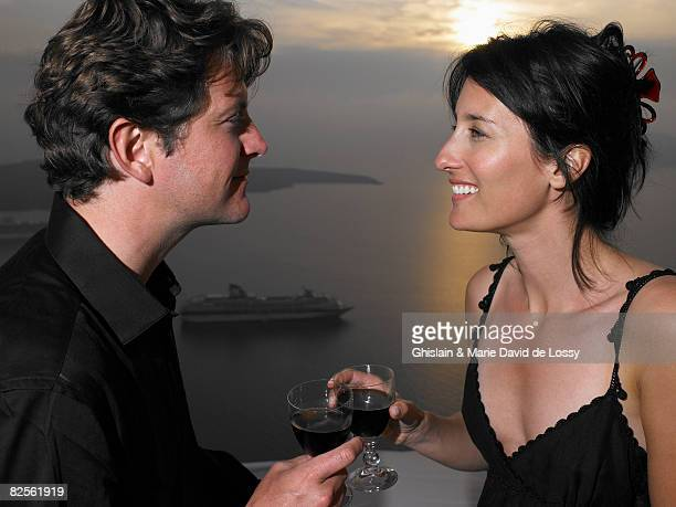 Couple toasting glasses, sea view