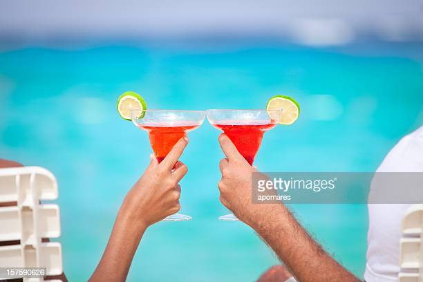 Couple toasting on a Tropical turquoise beach