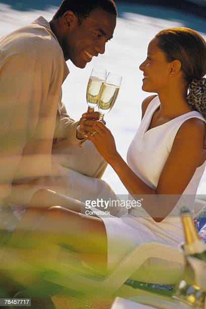 Couple toasting wine outdoors