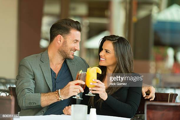 Couple toasting with cocktails at restaurant
