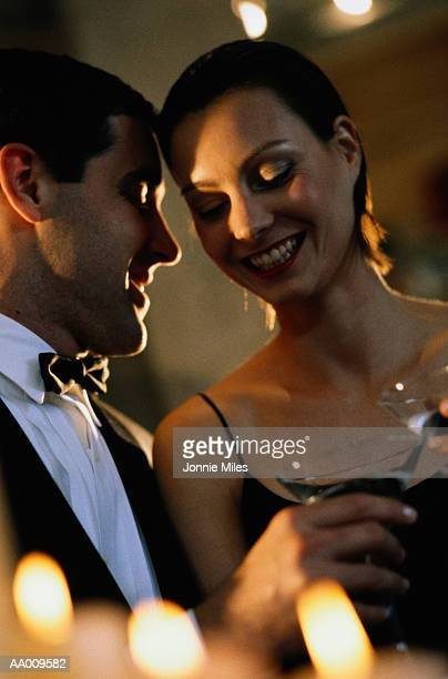 Couple Toasting with Martinis