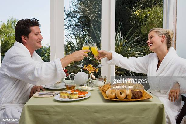Couple toasting with mimosas