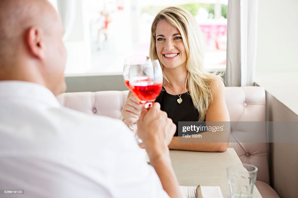 Couple toasting with red wine in restaurant : Stock Photo