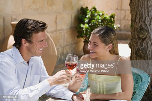 Couple toasting with red wine : Foto stock
