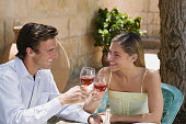 Couple toasting with red wine