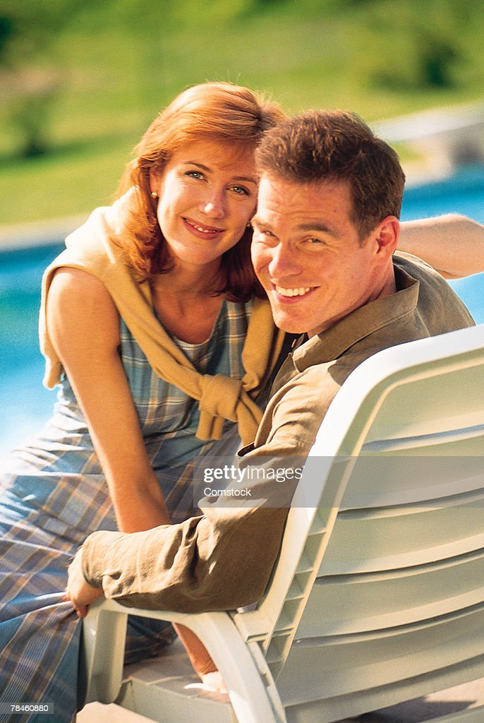 Couple together in lounge chair : Stock Photo