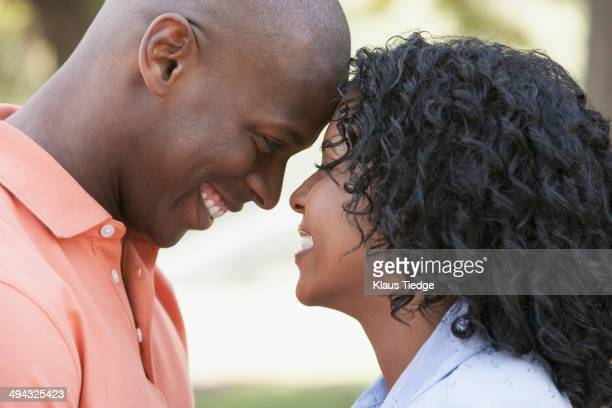 Couple touching foreheads outdoors