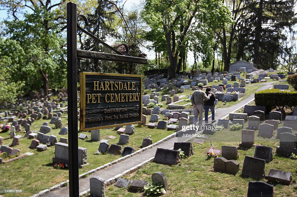 A couple tours the Hartsdale Pet Cemetery and Crematory while choosing a future plot for their pet on April 30, 2012 in Hartsdale, New York. The cemetery, established in 1896, is the oldest pet cemetery in the United States and serves as the final resting place for tens of thousands of animals. Pet owners can spend as much as $20,000 for a large plot to bury multiple pets and as little as $300-400 for small plots to bury ashes if they choose cremation. Pet owners also have the option of eventually having their own ashes buried in the plot, alongside their pets.
