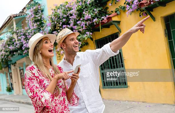 Couple traveling and using map on a cell phone