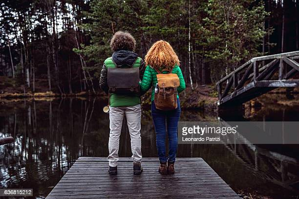 Couple traveling in mountain, amazed looking at landscape