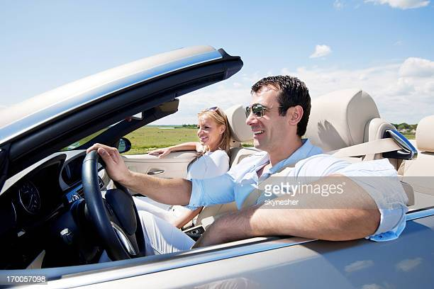 Couple travelling in a Convertible car.