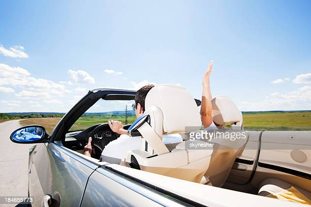 Couple travelling in a Convertible car