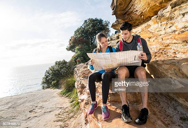 Couple trekking and holding a map