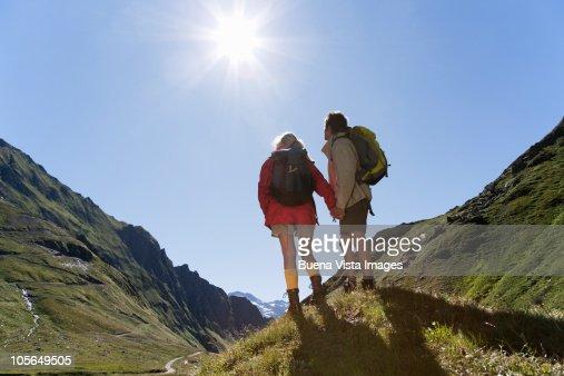 Couple trekking in the mountains : Stock Photo