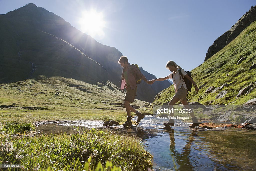 Couple trekking in the mountains : Stock Photo