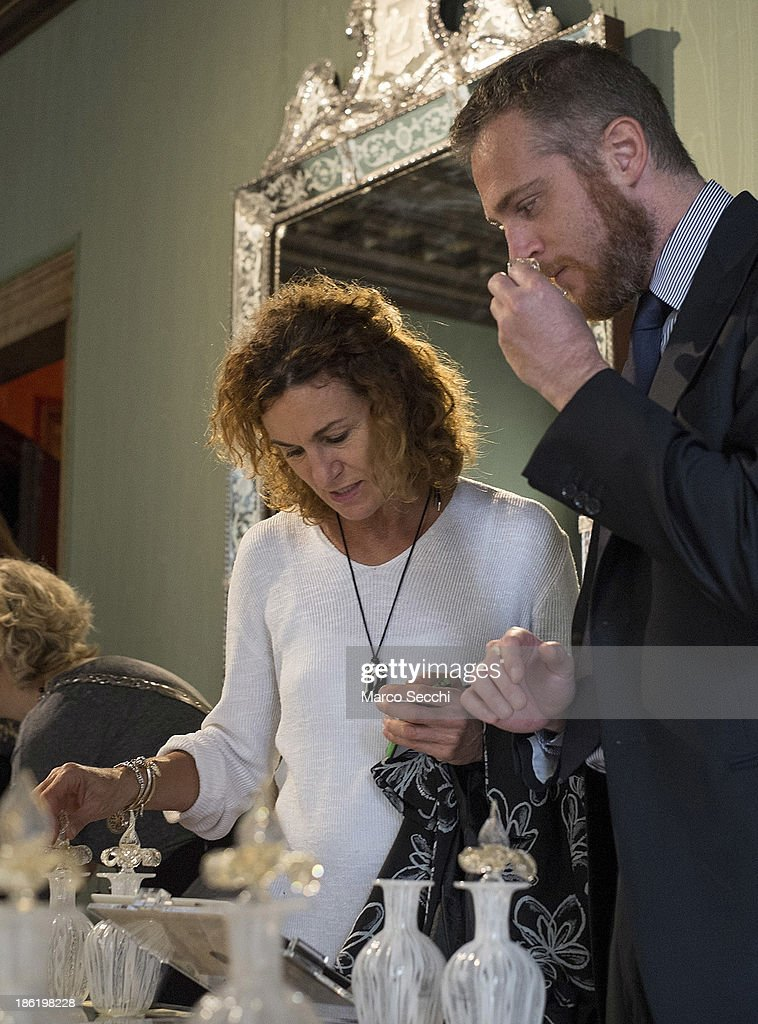A couple try different fragrances during the press preview of the perfume exhibition on October 29, 2013 in Venice, Italy. The new perfume section at the Venetian Museum of eighteenth-century lifestyle Palazzo Mocenigo will open on the 1st of November.