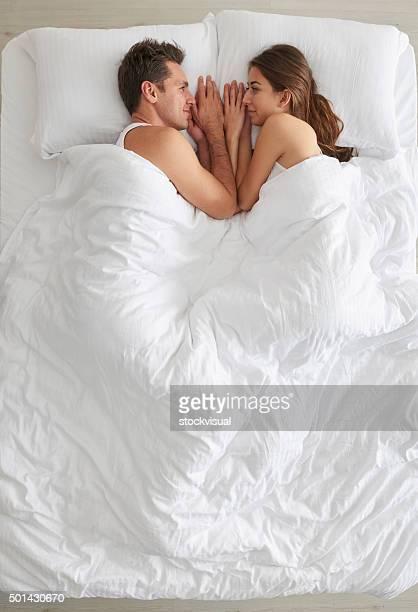 Couple under bedspread