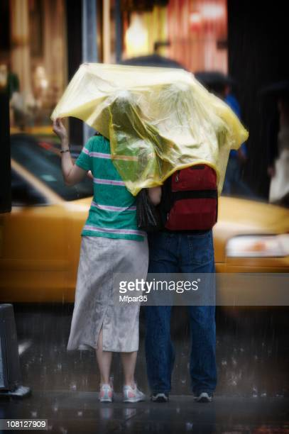 Couple under one cover in the rain
