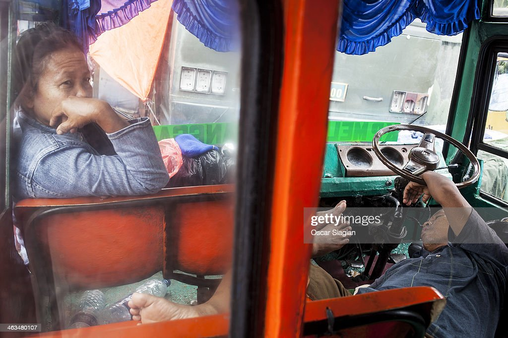 A couple use a bus for temporary shelter after floods hit their home at Manggarai Area on January 18 2014 in Jakarta Indonesia Over 40000 people have...