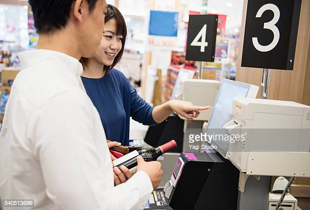 Couple using a digital cash register and check-out system