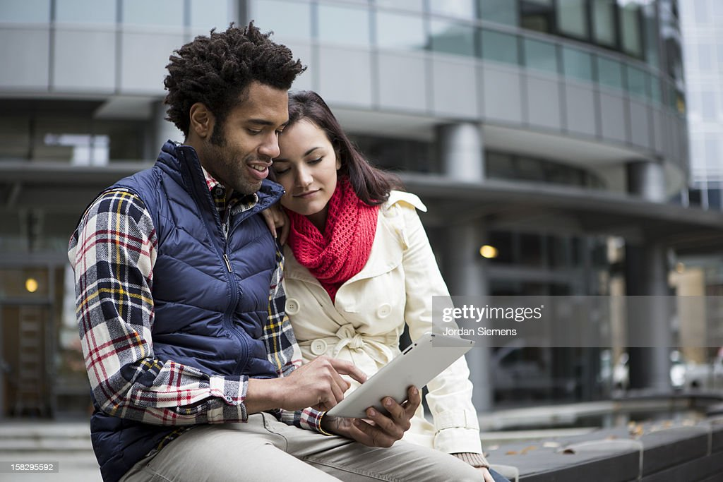 A couple using a digital tablet. : Stock Photo