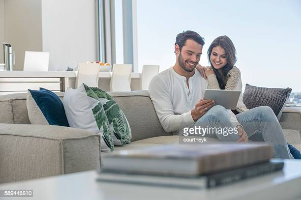 Couple using a digital tablet.