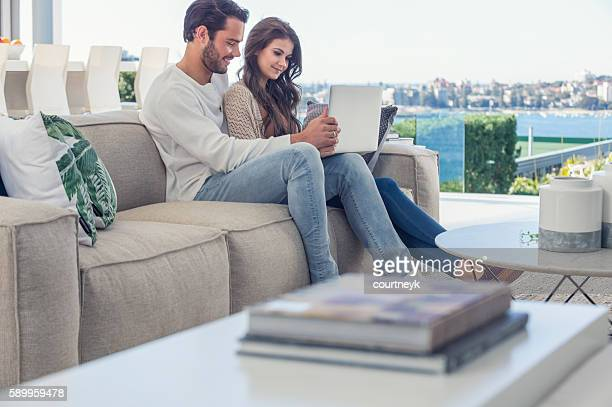 Couple using a laptop computer.