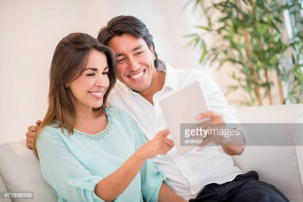Couple using a tablet at home on wifi