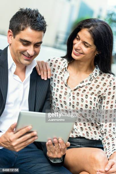 couple using an electronic tablet