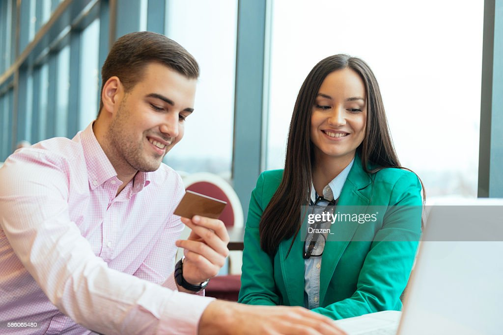 Couple using credit card for online shopping