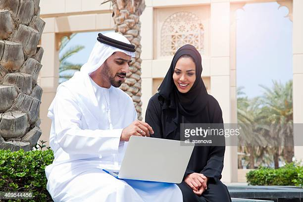 Couple Using Digital Tablet in Dubai.
